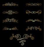Elementos rizados del oro en el negro - sistema Foto de archivo libre de regalías
