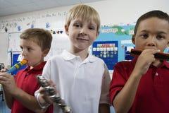 Elementära studenter i musikgrupp Royaltyfri Bild