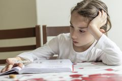 Elementry student reading your homework royalty free stock photos