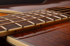 Elements of acoustic guitar. Acoustic guitar elements close up as background Royalty Free Stock Photography