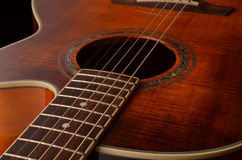 Elements of acoustic guitar. Acoustic guitar elements close up as background Royalty Free Stock Photo