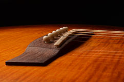 Elements of acoustic guitar. Acoustic guitar elements close up as background Stock Photo