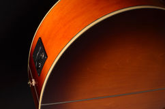 Elements of acoustic guitar. Acoustic guitar elements close up as background Stock Images