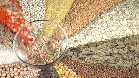 Elements of a Balanced Diet. In a glass bowl filled mix of different types of lentils and peas. Cup on the background of various kinds of cereals and legumes stock footage