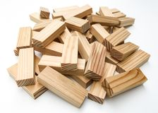Elements for the board game. Wooden bars for a board game in a tower puzzle Jenga. Chaotic scattered on a white background stock photos