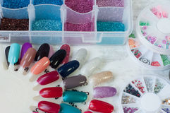 Elements for Building for Nails. Samples of nail polish and various kinds of decorative elements of decoration stock photos