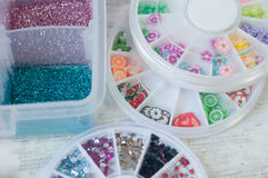 Elements for Building for Nails. Samples of nail polish and various kinds of decorative elements of decoration stock images