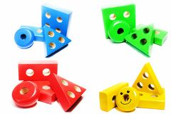 Geometric elements from children`s wooden educational toys grouped by color. Elements from children`s puzzle toys on the development of representations about Stock Images