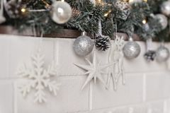 Elements of Christmas decorations and toys on the mantelpiece 93. Shelf fireplace decorated with Christmas toys and garlands Royalty Free Stock Photography