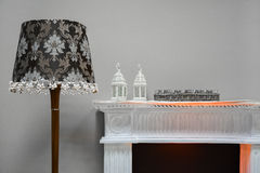 Elements decor. Floor lamp two lamps and glasses on the mantelpiece.  Stock Image