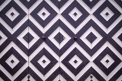 Pattern of black and white rhombuses on old doors. Elements of design in the form of geometric figures - black and white rhombuses on the ancient doors Stock Photo