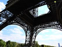 Elements of the Eiffel tower in Paris against a blue clear sky royalty free stock images