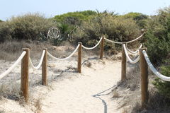 Elements of fence on the beach Royalty Free Stock Photography