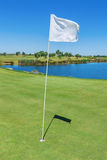 Elements of a golf course flag and hole. Vertical. Royalty Free Stock Photography