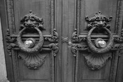 Elements of the input front door in the entrance of a house in Paris. Royalty Free Stock Image