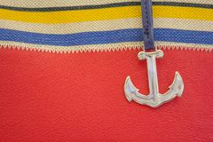 Elements of marine themes. An anchor on a red background Royalty Free Stock Images