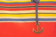 Elements of marine themes. An anchor on a red background Stock Photos