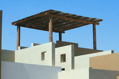 Elements of Mexico. Rooftop pergola built in Southwestern architectural style in Southern Baja Mexico under a  blue sky Stock Photography