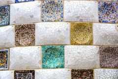 Elements of mosaic fragments Gaudi`s mosaic work in Park Guell In winter in the city of Barcelona. Stock Image