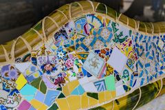 Elements of mosaic fragments Gaudi`s mosaic work in Park Guell In winter in the city of Barcelona. BARCELONA, SPAIN - 13 JANUARY 2018: Elements of mosaic stock images