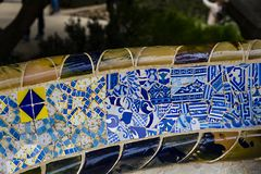 Elements of mosaic fragments Gaudi`s mosaic work in Park Guell In winter in the city of Barcelona. BARCELONA, SPAIN - 13 JANUARY 2018: Elements of mosaic stock photos
