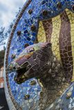 Elements of mosaic fragments Gaudi`s mosaic work in Park Guell In winter in the city of Barcelona. BARCELONA, SPAIN - 13 JANUARY 2018: Elements of mosaic stock image