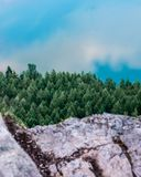 Elements of Nature. Lake, Trees, and rocky cliff view from the summit of a mountain stock images