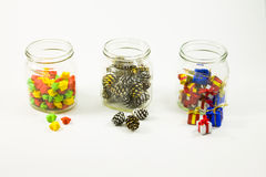 Elements of the New Year and Christmas decorations in glass jars Stock Photography