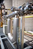 Elements of pipelines. Pipes and tanks in chemical factory Stock Image