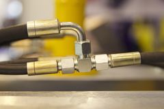 Elements of piping connections hydraulics and pneumatics. Machine tools Stock Images