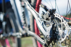 Elements of the suspension of the mtb bike of a two-pendant mountain bike close-up brake disc brake royalty free stock photo