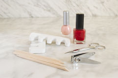 Elements to make a manicure. Nail polish nail clipper toe dividers and Cuticle pushers Stock Photography