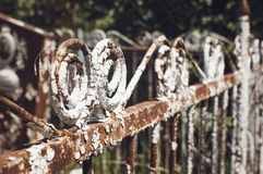 Elements of a very old vintage metal fence, Closeup, selective focus. Elements of a very old vintage metal fence, Close up, selective focus royalty free stock photo