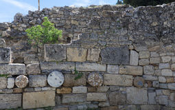 The elements of the wall of a ruined ancient house. Beautiful background of the ruins of Greek cities. Royalty Free Stock Photos