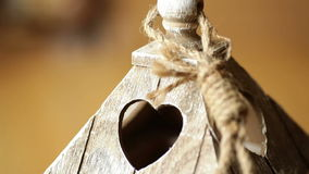 Elements wooden candlestick close-up with a window in the form of heart stock video