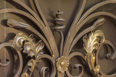Elements of wrought-iron gate decor royalty free stock photography