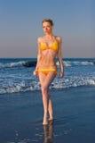 Elena on the beach. Lovely girl on the beach with an orange bikini Stock Photo