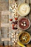 Elenchi i burri di dado, il pistacchio, la nocciola e l'anacardio tostati immagine stock