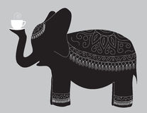 Elephant. A large beautiful elephant carries the cup of fragrant tea Royalty Free Stock Image