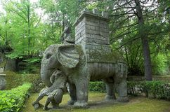 The Elephant. The tower, the guide and the legionaire in Bomarzo ville of wandares known as the moster park Royalty Free Stock Photo