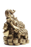 Elephant. Handcrafted indian elephant, mother with her baby elephant standing on coins royalty free stock photography