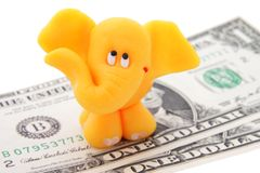 Elephant. Small elaphant with one dollar banknotes Stock Images