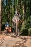 Elephant Arrival Spot. Tourists ride an elephant Stock Photography