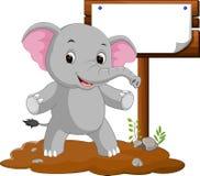 Elephant cartoon with a blank sign Royalty Free Stock Photos