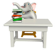 Elephant cartoon character with table and chair and book stack Royalty Free Stock Photos