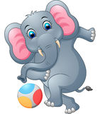 Elephant cartoon kicking a ball stock images