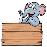 Elephant cartoon with a wooden sign Stock Photography