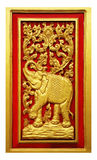 Elephant carved gold paint Stock Photography