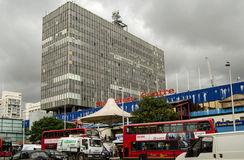 Elephant and Castle Shopping Centre. LONDON, UK  JUNE 16, 2014:  Busy traffic outside the dilapidated Elephant and Castle Shopping Centre in Southwark, South Stock Image