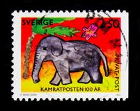 Elephant, Children's Drawings serie, circa 1992. MOSCOW, RUSSIA - OCTOBER 3, 2017: A stamp printed in Sweden shows Elephant, Children's Drawings stock image